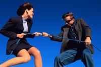Man and woman tug-o-war
